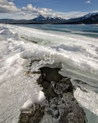 Ice on shrinking Abraham Lake, Alberta